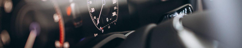 Car dashboard and wheel close up